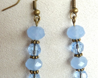 Earrings in bronze and blue beads