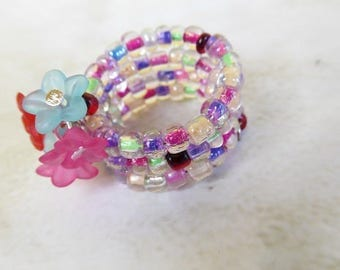 "Ring memory ""seed beads and flowers"""