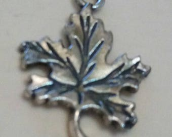 leaf worked finely carved tree metal charm