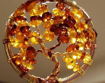 Handmade wire wrapped tree of life pendant in copper wire and genuine Baltic Amber