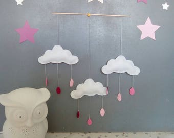 Mobile clouds and raindrops in shades of pink