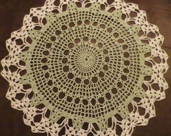 The Green and ecru crochet doily