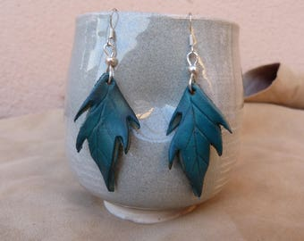 Small turquoise leather leaves