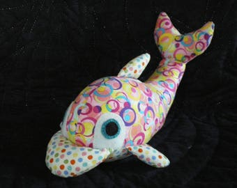 Dolphin made of multicolored patchwork fabric