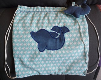 """Backpack """"toy"""" made clay dolphin and star fabric."""