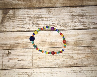 Rainbow skull bracelet with lava beads that makes taking your essentials oils with you a breeze. Adult size.