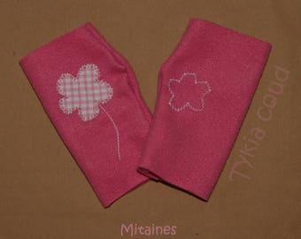 Pink fleece mittens, asymmetrical, with flower pattern