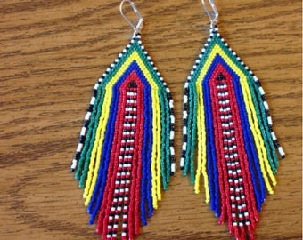 new my creation is handmade earrings woven Rainbow nine