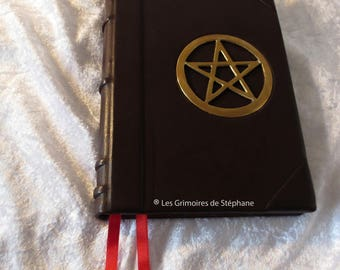 Brown leather bound Grimoire and Golden pentacle