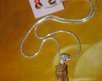 glass bottle and polymer clay necklace and the 3 pairs of earrings chip