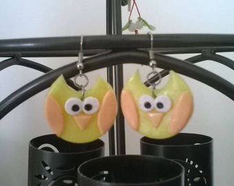 Small yellow and orange owls