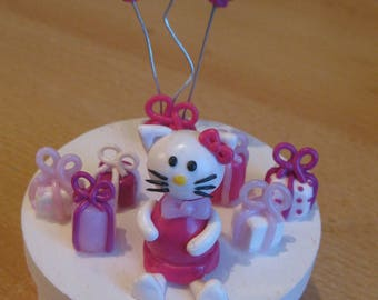 Pink and white cat with balloons and gift box