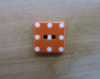 Orange square button with polka dots