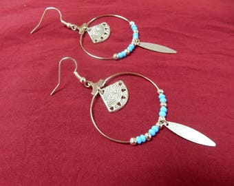 The natural circles earrings blue feather silver