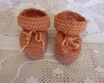 booties-3 months crocheted hands
