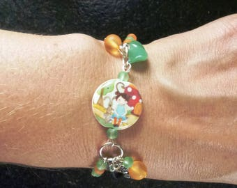 Bracelet with Pearl motif porcelain girl, assorted beads and charms mounted on black leather cord