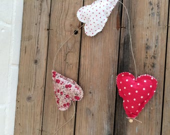 3 little hearts in red tissue Garland
