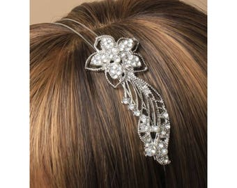 Double wire silv aliceband with large crystal trailing flower decoration.