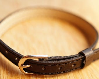 black faux leather padded strap.