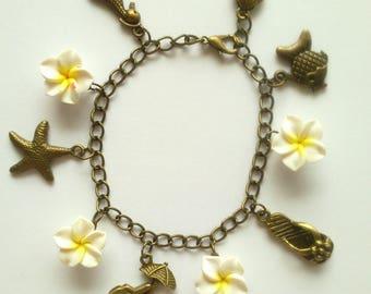 """""""Beach and Hawaiian flower"""" charm bracelet"""