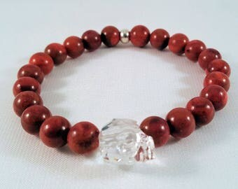 Precious gemstone bracelet made of coral, Swarovski crystal skull in crystal, silver bead, elastic band