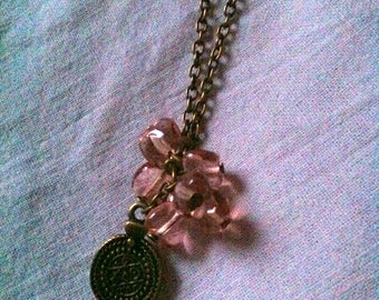 Bronze medallion necklace and pink beads
