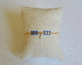 Flower gold chain and Royal Blue spike bracelet