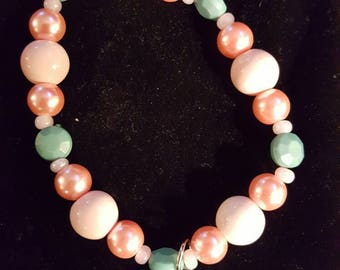 Pink and green beaded bracelet with flip flop charm