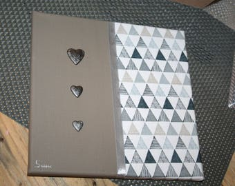 Gray table and taupe triangle and its Scandinavian spirit hearts