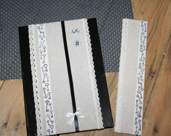 notebook and his trademark black linen and lace recipe pages