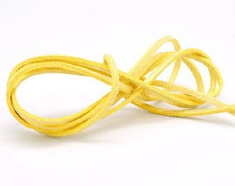 2 dangles of yellow suede cords
