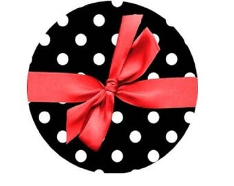 20mm, red bow on black background with dots.