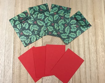 Four holiday gift tags with envelopes