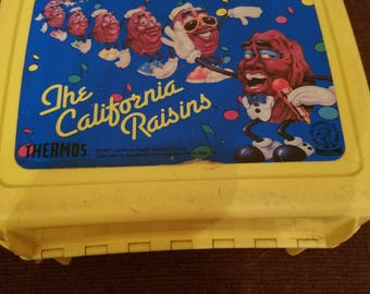 Vintage plastic california raisins lunch box with thermos