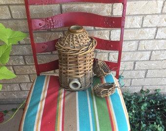 Vintage wicker covered ceramic jug