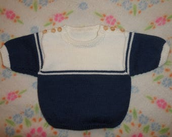 "KNITTED SWEATER in size 2 years, ""Alpine"" and white, blue short sleeve."