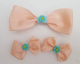 Cochlear implant bows and a matching sibling bow