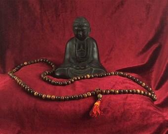 Buddhist-style long wood bead mala with carved wood skull and hand-made hemp tassel