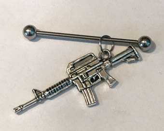 Silver colored punk gun rifle charm on stainless steel 14g industrial body jewelry, scaffold piercing, supports animal rescue