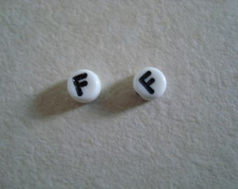 Two beads black f white background