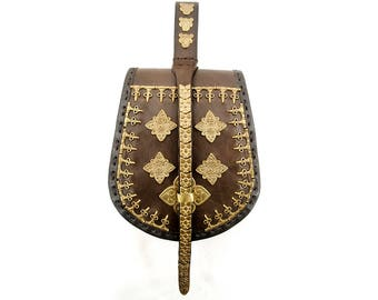 medieval scale-shaped viking leather purse with brass fittings, replica of Jamtland finding