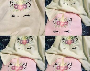 Unicorn sleeping blanket in pink and cream
