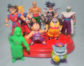 9 Son Goku Dragon Ball figures from the 90s.