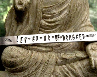 Let Go or Be Dragged - bracelet - Buddhist saying