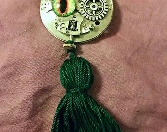 Steampunk green eyed tassel brooch