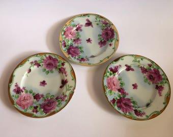 Set of three pretty saucers