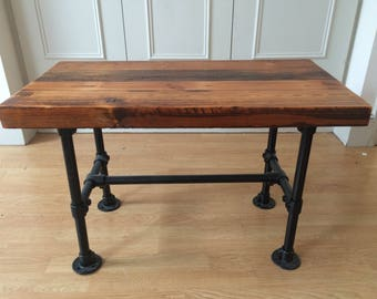 Handcrafted renovated floorboard table and scaff legs