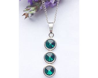 Sterling silver trio pendant necklace made with emerald green Swarovski crystal