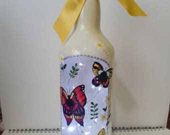 Stunningly beautiful hand painted glass bottle lamp with butterflies and LED lights