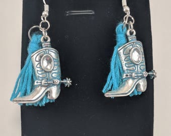 Blue and silver cowboy boot earrings with blue fringe accents and diamond rhinestone